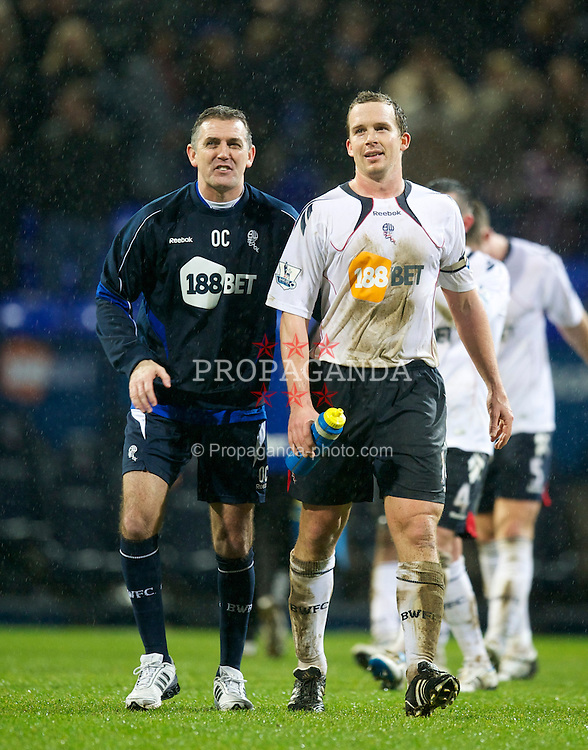BOLTON, ENGLAND - Sunday, February 13, 2011: Bolton Wanderers' manager Owen Coyle celebrates with captain Kevin Davies after his side's 2-0 victory over Everton during the Premiership match at the Reebok Stadium. (Photo by David Rawcliffe/Propaganda)
