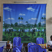 A roadside restaurant displays a utopian scene in Ha Giang, Vietnam's northernmost province, 21 June, 2007. As cities like Hanoi and Ho Chi Minh roar with Vietnam's economic boom, Ha Giang remains a quiet, serene and beautiful mountain backwater along the Chinese border.