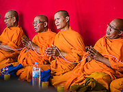 21 JANUARY 2017 - BANGKOK, THAILAND:  Buddhist monks lead a prayer service for people in Phra Khanong Market in Bangkok. The market serves a mix of foreign residents, local people, and Burmese migrants.      PHOTO BY JACK KURTZ