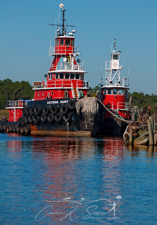 Two tug boats are moored at the old state docks in Bayou La Batre, Ala. Nov. 17, 2010. The Gulf Coast continues to recover from this summer's Deepwater Horizon BP oil spill, which affected nearly 29,000 square miles of shoreline from Louisiana to Florida. (Photo by Carmen K. Sisson/Cloudybright)