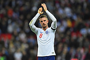 Jordan Henderson of England applauds the fans at full time after England won 5-0 during the UEFA European 2020 Qualifier match between England and Czech Republic at Wembley Stadium, London, England on 22 March 2019.