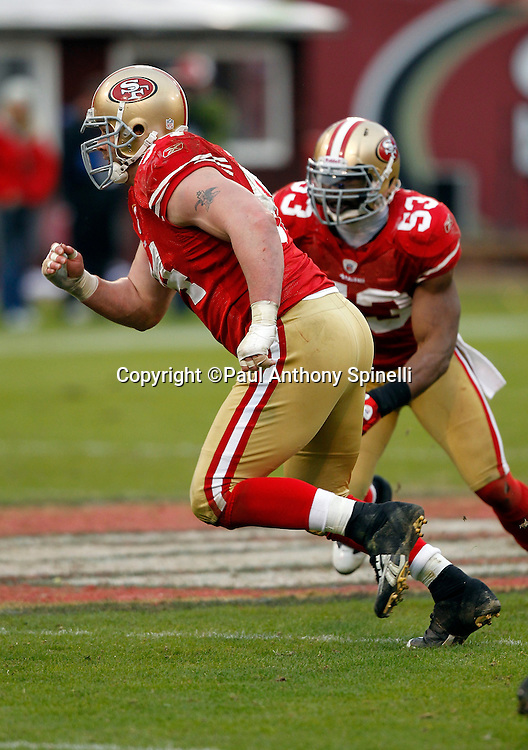 San Francisco 49ers defensive tackle Justin Smith (94) rushes the quarterback during the NFL week 17 football game against the Arizona Cardinals on Sunday, January 2, 2011 in San Francisco, California. The 49ers won the game 38-7. (©Paul Anthony Spinelli)