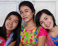YANGON, MYANMAR - CIRCA DECEMBER 2017: Young Burmese women looking at Camera.