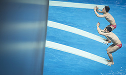 June 5, 2018 - Wuhan, China - China's Cao Yuan (Front) and Xie Siyi compete during the men's 3m springboard synchronized final at the FINA Diving World Cup 2018 in Wuhan, central China's Hubei Province, on June 5, 2018. Cao Yuan and Xie Siyi claimed the title with a total of 448.74 points. (Credit Image: © Xiao Yijiu/Xinhua via ZUMA Wire)