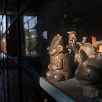 Pre-Columbian artifacts in a publicly accessible storage area of the Museo Larco in Lima, Peru.
