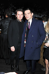 Left to right, CHRISTOPHER KANE and ERDEM MORALIOGLU at a party hosted by TopShop to celebrate 10 years of NEWGEN and 10 years of supporting Brtish Fashion held at Le Baron, 29 Old Burlington Street, London W1 on 21st February 2012.
