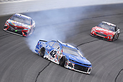 July 1, 2018 - Joliet, Illinois, United States of America - Kyle Larson (42) goes for a spin after connect with Kyle Busch (18) while coming to the checkered flag to win the Overton's 400 at Chicagoland Speedway in Joliet, Illinois  (Credit Image: © Chris Owens Asp Inc/ASP via ZUMA Wire)
