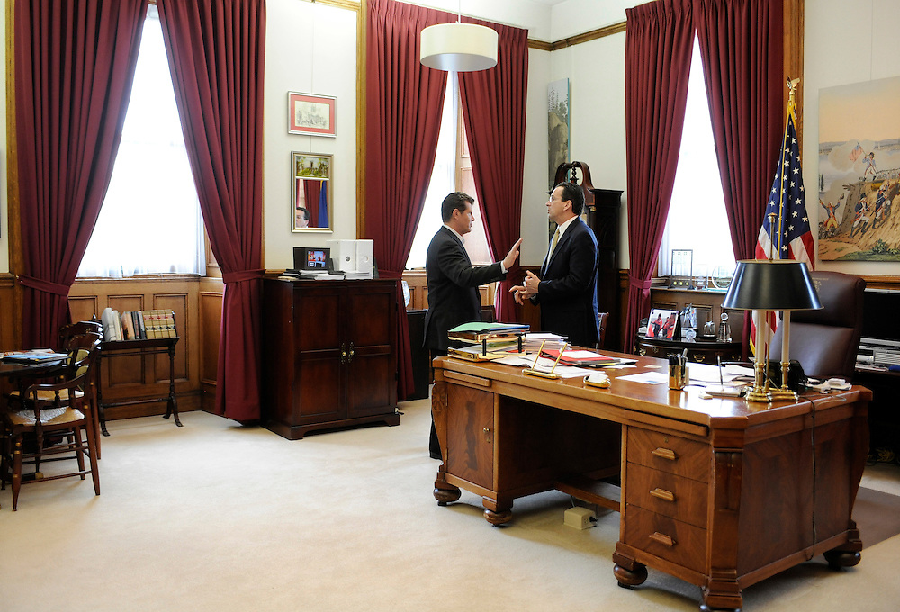 Connecticut women's basketball head coach Geno Auriemma, left, has a private conversation with Gov. Dannel P. Malloy in the governor's office during Husky Day at the Capitol in Hartford, Conn., Wednesday, April 27, 2011. (AP Photo/Jessica Hill)