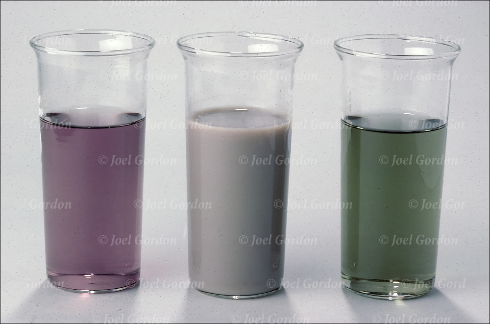 Chemistry experiment , Reaction of an Amphoteric Hydroxide. Initially all three beakers contained a suspension of chromium (III) hydroxide, Cr(0H)3. The middle beaker remains untreated. The hydroxide on the left was dissolved by adding concentrated HCI(aq) to form violet-colore Cr3+(aq). The hydroxide on the right was dissolved by adding concentrated Na0H to form green Cr(0H)4-(aq).