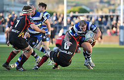 Paul James (Bath) is tackled in possession - Photo mandatory by-line: Patrick Khachfe/JMP - Tel: Mobile: 07966 386802 11/01/2014 - SPORT - RUGBY UNION -  Rodney Parade, Newport - Newport Gwent Dragons v Bath - Amlin Challenge Cup.
