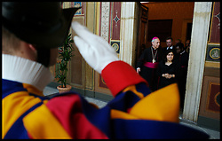 Sayeeda Warsi gets a salute from the Swiss Guard as she makes her way to see the  Pope inside the Vatican. Sayeeda Warsi has brought the largest British delegation to the Vatican, Wednesday February 15, 2012. Photo by Andrew Parsons/ I-images.BYLINE MUST READ ANDREW PARSONS/i-Images