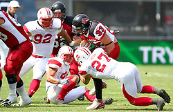 13.07.2011, UPC Arena, Graz, AUT, American Football WM 2011, Group B, Japan (JAP) vs Canada (CAN), im Bild Atsushi Tsuji (Japan, #27, DB) tries to stop the rush from Matt Walters (Canada, #33, RB) through the middle // during the American Football World Championship 2011 Group B game, Japan vs Canada, at UPC Arena, Graz, 2011-07-13, EXPA Pictures © 2011, PhotoCredit: EXPA/ T. Haumer