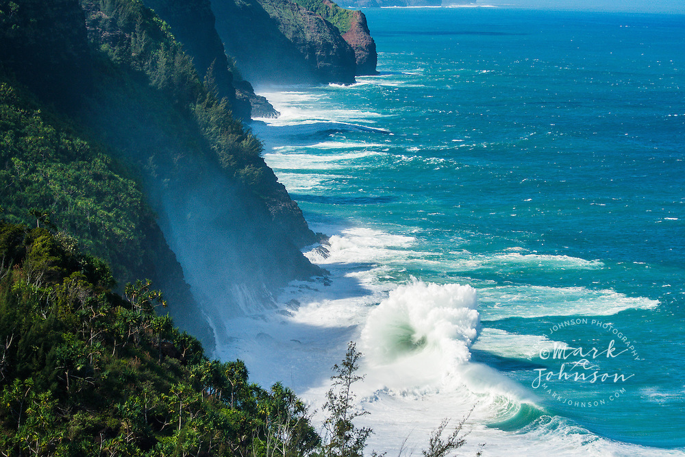 Large winter surf breaking off the Na Pali Coast of Kauai, Hawaii, USA