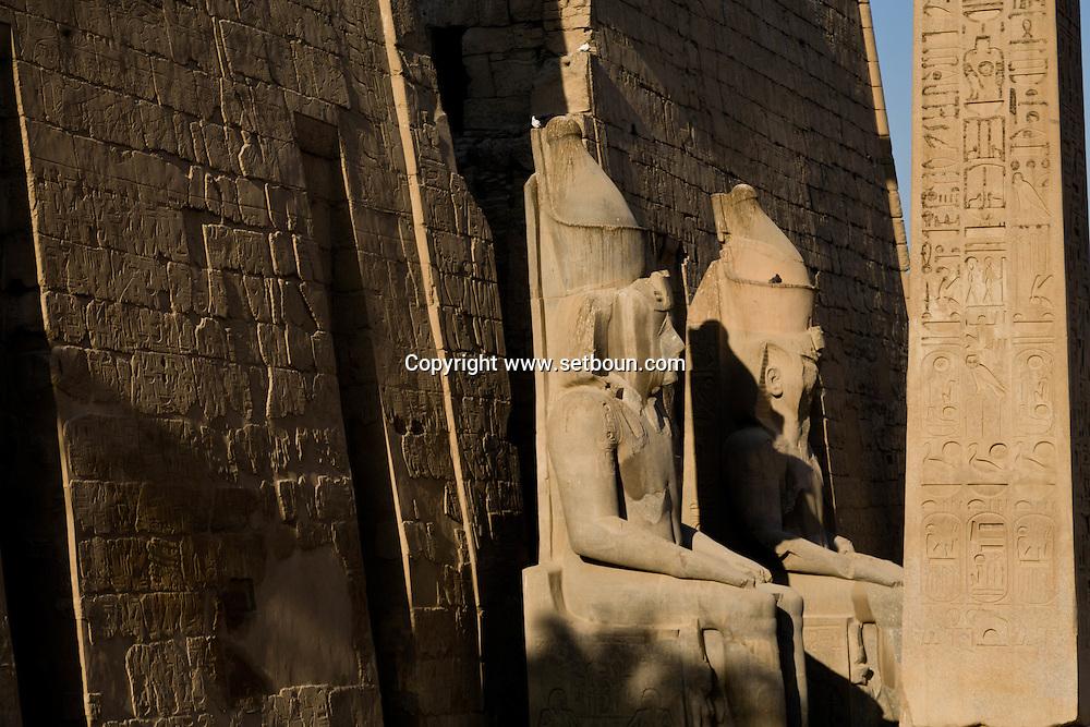 Louxor temple   Ramses statue and obelisque at the entrance of the first pylone, it's the brother of Paris , place de la Concorde obelisque  Louxor - Egypt    /  temple de Louqsor, statue de ramses et obelisque devant le premier pylonne  Louqsor - Egypte