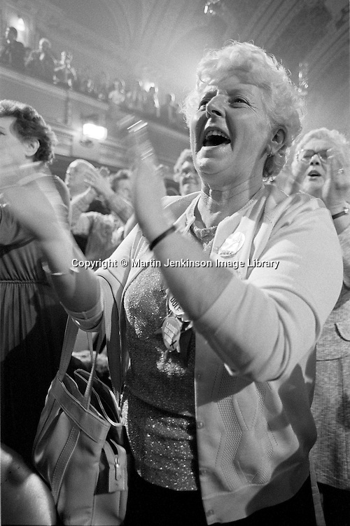 Cllr Margaret Hughes applauding the speaker at a Labour Party rally in support of striking miners during the 1984-85 strike. Stoke -on Trent 30/11/1984.
