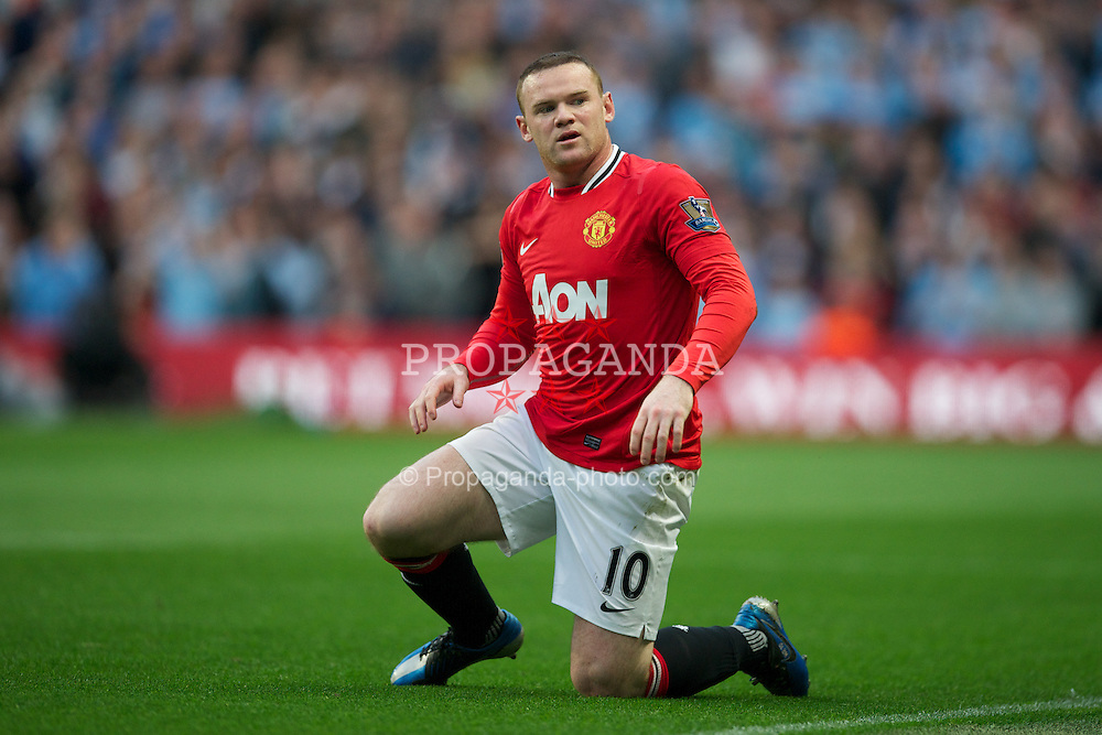 MANCHESTER, ENGLAND - Monday, April 30, 2012: Manchester United's Wayne Rooney.looks dejected during the Premiership match against Manchester City at the City of Manchester Stadium. (Pic by David Rawcliffe/Propaganda)