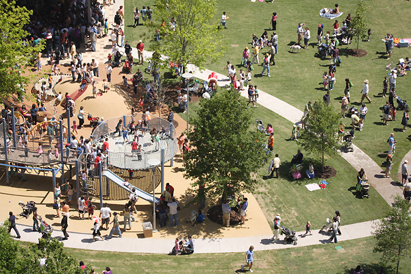 Stock photo of an aerial view of people enjoying the park and playground