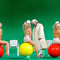 Picture shows : Adrian Powter as Taddeo with bunny girls...Picture  ©  Drew Farrell Tel : 07721 -735041..A new Scottish Opera production of  Rossini?s 'The Italian Girl in Algiers' opens at The Theatre Royal Glasgow on Wednesday 21st October 2009..(Soap) opera as you've never seen it before.Tonight on Algiers?..Colin McColl?s cheeky take on Rossini?s comic opera is a riot of bunny girls, beach balls, and small screen heroes with big screen egos. Set in a TV studio during the filming of popular Latino soap, Algiers, the show pits Rossini?s typically playful and lyrical music against the shoreline shenanigans of cast and crew. You?d think the scandal would be confined to the outrageous storylines, but there?s as much action off set as there is on?..Italian bass Tiziano Bracci makes his UK debut in the role of Mustafa. Scottish mezzo-soprano Karen Cargill, who the Guardian called a ?bright star? for her performance as Rosina in Scottish Opera?s 2007 production of The Barber of Seville, sings Isabella..Cast .Mustafa...Tiziano Bracci.Isabella..Karen Cargill.Lindoro...Thomas Walker.Elvira...Mary O?Sullivan.Zulma...Julia Riley.Haly...Paul Carey Jones.Taddeo...Adrian Powter..Conductors.Wyn Davies.Derek Clarke (Nov 14)..Director by Colin McColl.Set and Lighting Designer by Tony Rabbit.Costume Designer by Nic Smillie..New co-production with New Zealand Opera.Production supported by.The Scottish Opera Syndicate.Sung in Italian with English supertitles..Performances.Theatre Royal, Glasgow - October 21, 25,29,31..Eden Court, Inverness - November 7. .His Majesty?s Theatre, Aberdeen  - November 14..Festival Theatre,Edinburgh - November 21, 25, 27 ...Note to Editors:  This image is free to be used editorially in the promotion of Scottish Opera. Without prejudice ALL other licences without prior consent will be deemed a breach of copyright under the 1988. Copyright Design and Patents Act  and will be subject to payment or legal action, where appropriate..Further further informat