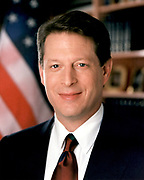 Albert Arnold 'Al' Gore, Jr. (born 1948) served as the 45th Vice-President of the United States 1993-2001 under President Bill Clinton. Head-and-shoulders portrait with stars-and-stripes in background. American Politician