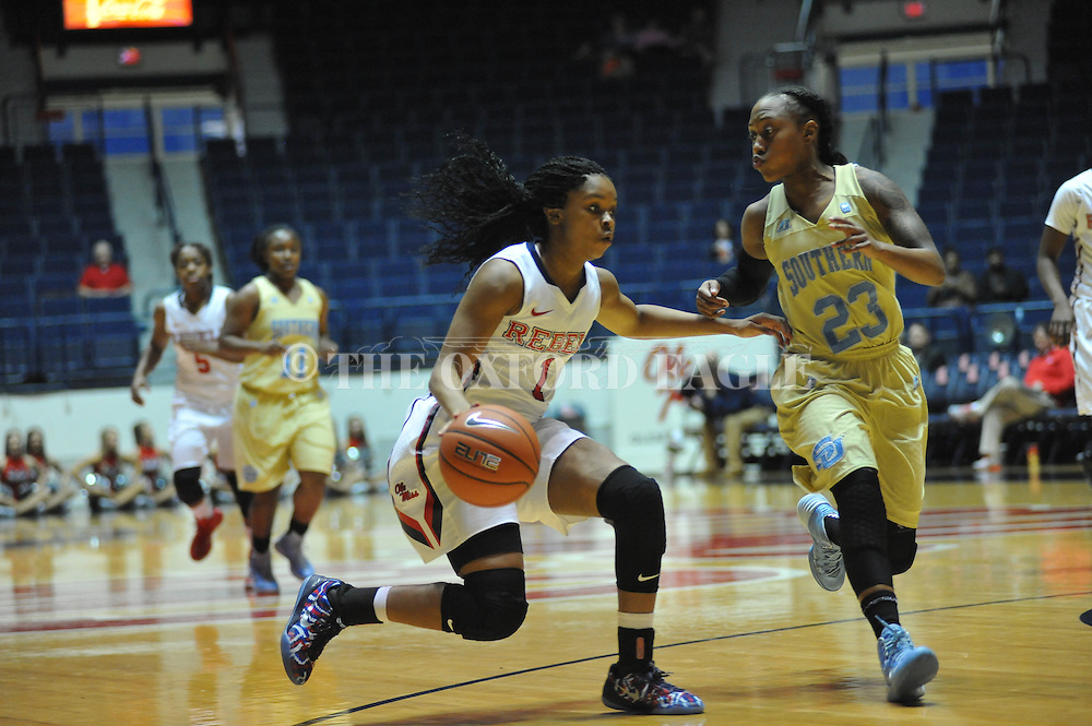 "Ole Miss guard Toree Thompson (1) drives against Southern University Jaguars guard Kendra Coleman (23) at the C.M. ""Tad"" Smith Coliseum in Oxford, Miss. on Thursday, November 20, 2014. (AP Photo/Oxford Eagle, Bruce Newman)"