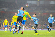 Uruguay defender Matias Vecino (13) beats Brazil forward Roberto Firmino (20) to a header during the Friendly International match between Brazil and Uruguay at the Emirates Stadium, London, England on 16 November 2018.