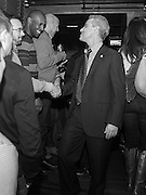 Chicago mayor Rahm Emanuel shakes hands with patrons of Side Track bar while celebrating the Illinois House passing a bill for same sex marriage Tuesday evening in Chicago. <br /> | Michael R. Schmidt-For Sun-Times Media