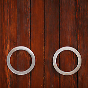 Two metal, circle-shaped handles on the doors of The Dwan Light Sanctuary, on the campus of the United World College-USA in Las Vegas, NM.