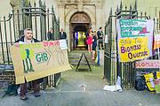 Biofuelwatch organise an early morning protest before the Green Investment Bank's Annual Review event.  They are pleased with the announcement on wind turbine investment but are still concerned about the money being put into biomass energy, such as that at Drax.  the LSO St Luke's, Old Street London, 25th June 2014.  Guy Bell, 07771 786236, guy@gbphotos.com