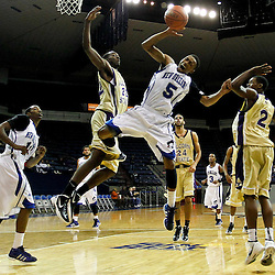 November 27, 2011; New Orleans, LA; Alcorn State Braves forward Chris Brand (22) defends as guard Twann Oakley (2) fouls New Orleans Privateers guard Antonio Holmes (5) on a shot during the first half of a game at the Lakefront Arena.  Mandatory Credit: Derick E. Hingle-US PRESSWIRE