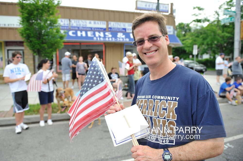 Charles Rosenblum, a Merrick Kiwanis member, marching in Merrick Memorial Day Parade on May 28, 2012, on Long Island, New York, USA. Rosenblum's father, American Legion member Everett Rosenblum, was Parade Grand Marshall. America's war heroes are honored on this National Holiday.