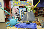 """Piney Point teachers decorated the library with sea-related still lifes in keeping with the theme """"Books are Treasures Waiting to be Discovered."""""""