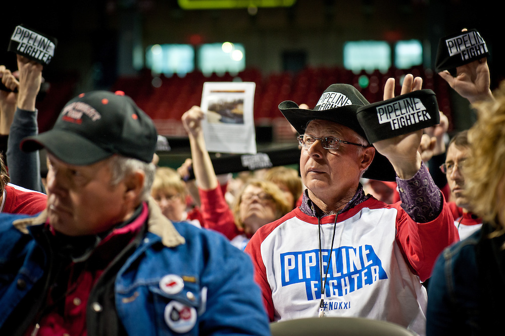"Ken Prososki wears a ""Pipeline Fighter"" t-shirt at the State Department hearing on the Keystone XL Pipeline Project in Grand Island."