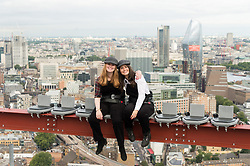 © Licensed to London News Pictures. 21/08/2018. London, UK. Guests take part in recreating one of the most iconic images on the 20th century; Lunch Atop a Skyscraper. Deliveroo invited lucky guests to sit on the steel girder and dine 450ft in the air suspended with a panoramic view of London enjoying the companies menu.  Photo credit: Ray Tang/LNP
