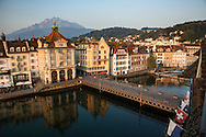 Bridge and buildings on the River Reuss at sunset, Lucerne, Switzerland
