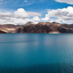 Pangong Tso is a lake in the Himalayas situated at a height of about 4,350 m (14,270 ft). It is 134 km long and extends from India to Tibet. 60% of the length of the lake lies in Tibet.