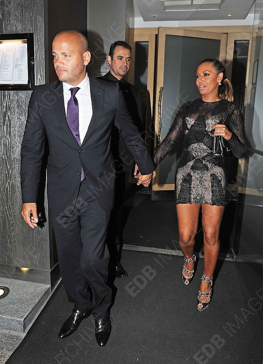 26.JUNE.2012. LONDON<br /> <br /> MEL B AND HUSBAND STEPHEN BELAFONTE LEAVING NOBU RESTAURANT, BERKLEY SQUARE.<br /> <br /> BYLINE: EDBIMAGEARCHIVE.CO.UK<br /> <br /> *THIS IMAGE IS STRICTLY FOR UK NEWSPAPERS AND MAGAZINES ONLY*<br /> *FOR WORLD WIDE SALES AND WEB USE PLEASE CONTACT EDBIMAGEARCHIVE - 0208 954 5968*