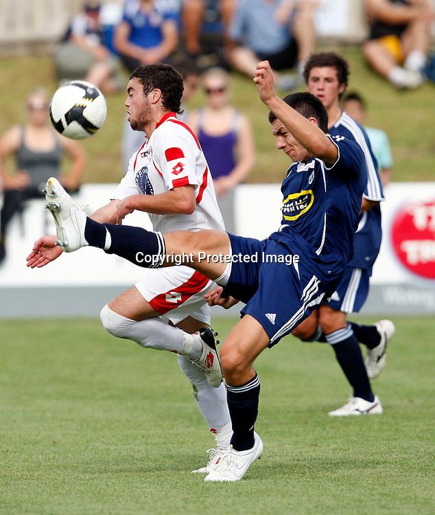 Auckland's Nikko Boxall clears the ball ahaed of Waitakere's Dakota Lucas. Lion Foundation Youth League Football, Waitakere United v Auckland City FC, Fred Taylor Park Whenuapai. Saturday 30th January 2010. Photo: Shane Wenzlick/PHOTOSPORT