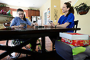 Riley Ljungdahl plays the game Uno with her mother Karen Ljungdahl after school, Friday, May 10, 2013, at her home in Longmont.<br /> (Matthew Jonas/Times-Call)