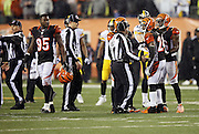 Cincinnati Bengals cornerback Adam Jones (24) has a conversation with field judge Buddy Horton (82) as NFL officials try to clear the field of players and coaches after a hard hit on Pittsburgh Steelers wide receiver Antonio Brown (84) at the end of the game by Cincinnati Bengals outside linebacker Vontaze Burfict (55) that causes altercations on the field during the NFL AFC Wild Card playoff football game against the Cincinnati Bengals on Saturday, Jan. 9, 2016 in Cincinnati. The Steelers won the game 18-16. (©Paul Anthony Spinelli)