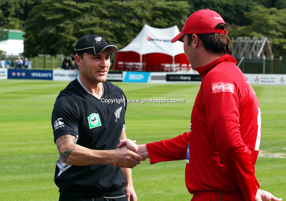 Brendon McCullum and Brendan Taylor at the coin-toss.<br /> New Zealand v Zimbabwe, 1st ODI, 3 February 2012, University Oval, Dunedin, New Zealand.<br /> Photo: Rob Jefferies/PHOTOSPORT