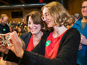 26 JANUARY 2020 - AMES, IOWA: US Senator AMY KLOBUCHAR (D-MN) walks into a campaign event at Jethro's BBQ in Ames. Sen. Klobuchar campaigned to support her candidacy for the US Presidency Sunday in central Iowa during the one day break from the impeachment trial of President Trump. She is trying to capitalize on her recent uptick in national polls. Iowa holds the first selection event of the presidential election cycle. The Iowa Caucuses are Feb. 3, 2020.     PHOTO BY JACK KURTZ