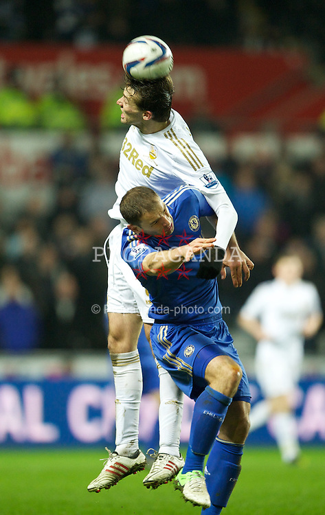 SWANSEA, WALES - Wednesday, January 23, 2013: Chelsea's Branislav Ivanovic in action against Swansea City's Miguel Perez Cuesta 'Michu' during the Football League Cup Semi-Final 2nd Leg match at the Liberty Stadium. (Pic by David Rawcliffe/Propaganda)