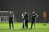 Swansea Manager Garry Monk &reg; looks on in the rain during Swansea city FC team training in Landore, Swansea, South Wales on Wed 19th Feb 2014. the team are training ahead of tomorrow's UEFA Europa league match against Napoli.<br /> pic by Phil Rees, Andrew Orchard sports photography.