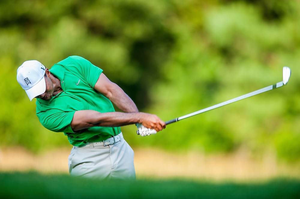 Tiger Woods hits his second shot from the fairway on the par-4 fourteenth hole at Congressional CC during the third round of the AT&T National in Bethesda, MD.