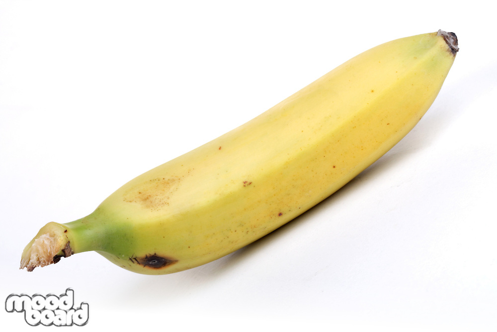 Close-up of banana on white background