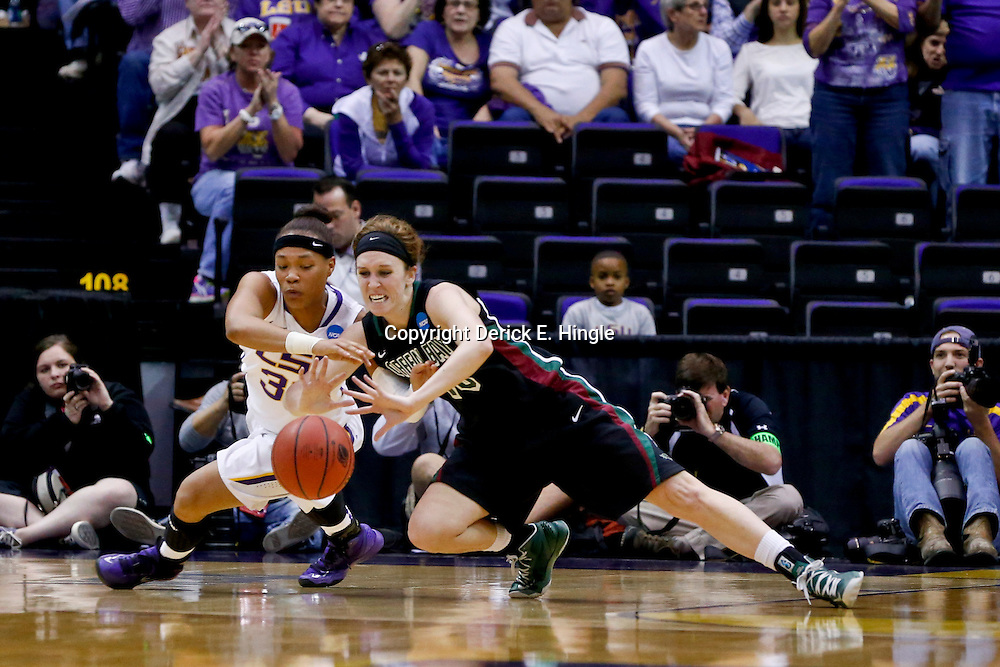 Mar 24, 2013; Baton Rouge, LA, USA; LSU Tigers guard Danielle Ballard (32) and Green Bay Phoenix guard Adrian Ritchie (13) scramble for a loose ball in the first half of the first round of the 2013 NCAA womens basketball tournament at the Pete Maravich Assembly Center.  Mandatory Credit: Derick E. Hingle-USA TODAY Sports