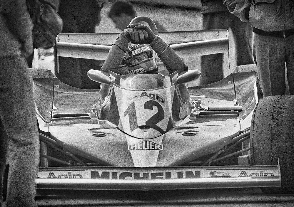 Ferrari legend Gilles Villeneuve, in his first full year with Scuderia Ferrari, patiently waits for changes to his Ferrari 312T3 as he prepares for qualifications for the 1978 United States Grand Prix. <br />