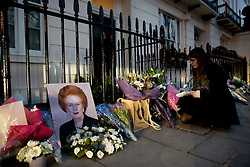 © Licensed to London News Pictures. 08/04/2013. London, UK. A  Margaret Thatcher portrait and flowers at the house where former Conservative Prime Minister Margaret Thatcher lived in central London. Lady Thatcher dies this mooring from a suspected stroke..Photo credit : Peter Kollanyi/LNP