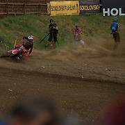 Tim Gajser shows what it means to deliver a stone spray sandwich.