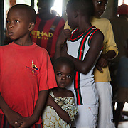 Children waiting to have their finger pricked to draw blood to test them for HIV/Aids. Volunteer Blessing and Doofan process the 120 children efficiently and kindly. All tests proved negative. EVA provide HCT in three rural communities near Makurdi in Benue state. Benue state has got one of the highest HIV prevalence in Nigeria and EVA aim to target vulnerable children who would otherwise miss out of being tested for HIV and therefor not know their HIV statues.  Education As a Vaccine Against Aids (EVA) in Nigeria.